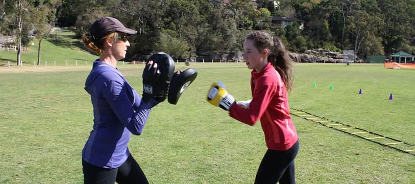 JusFitness trainer: Justine doing personal training with a young girl